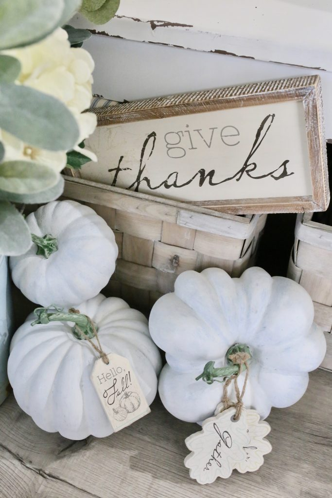 painted pumpkins with wood tags and signs