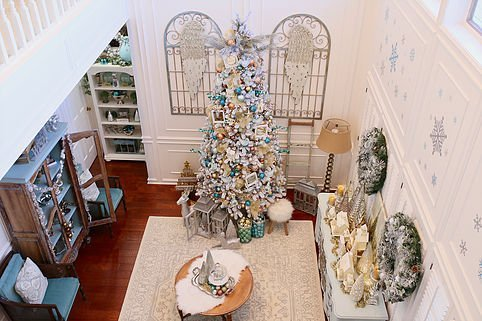 Our formal living room is right off the entry and opens up to the second story of our home. I snapped this picture from upstairs, to give you a glimpse of ...