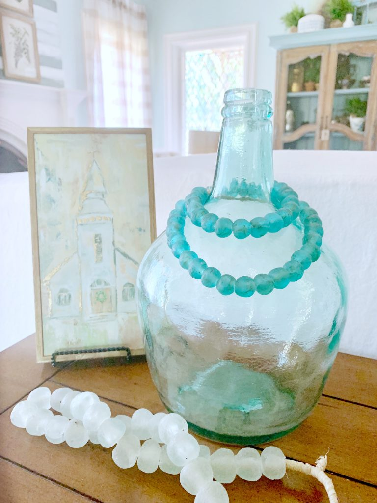 Decor beads looped over glass demijohn.