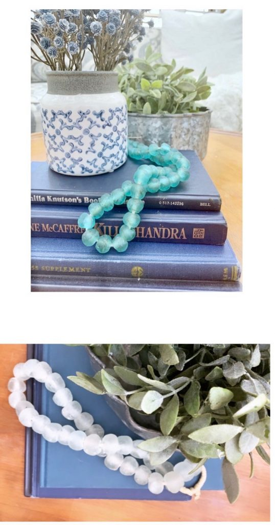 Style decor beads over a stack of books.