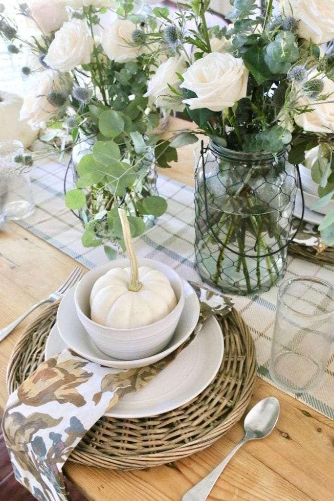 Add a pumpkin for fall at each table setting