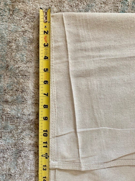 using the measurements fold the top of the drop cloth curtain accordingly