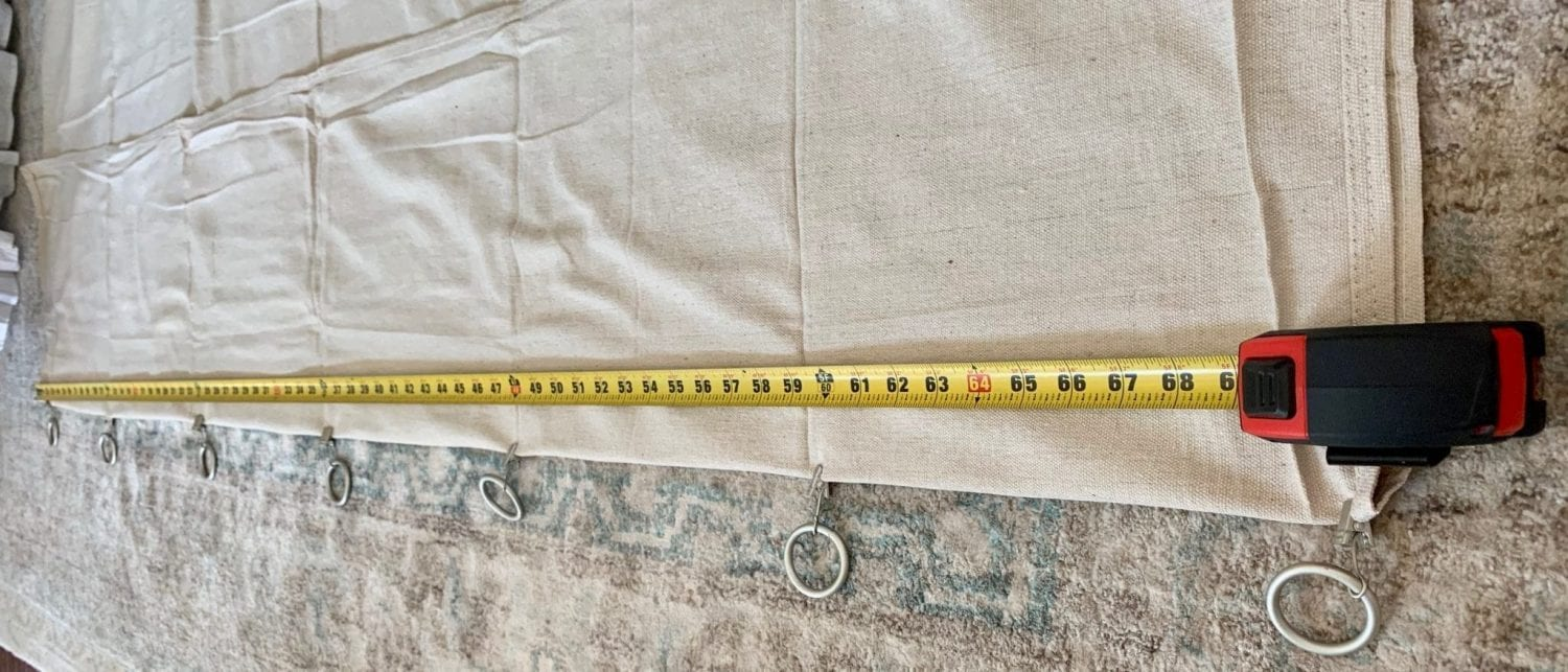 measuring tape over drop cloth marked in 1 foot incremements